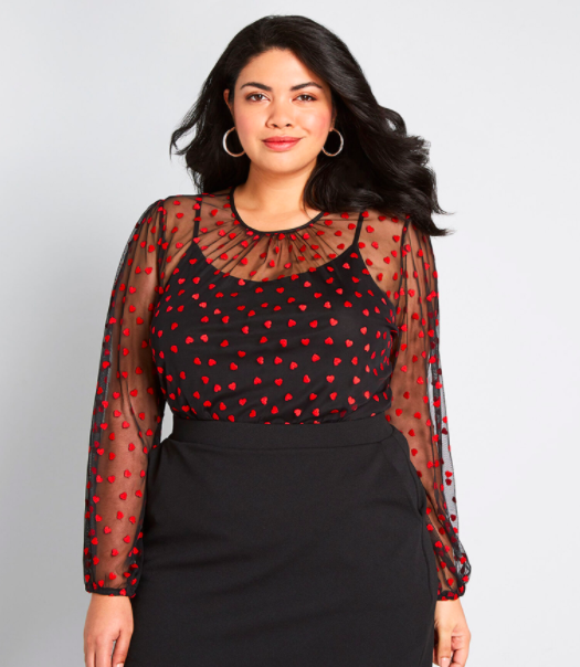 a sheer top with red hearts on it