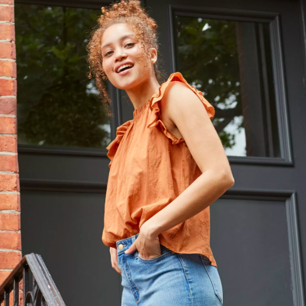 a brown/orange top with fluffy short sleeves