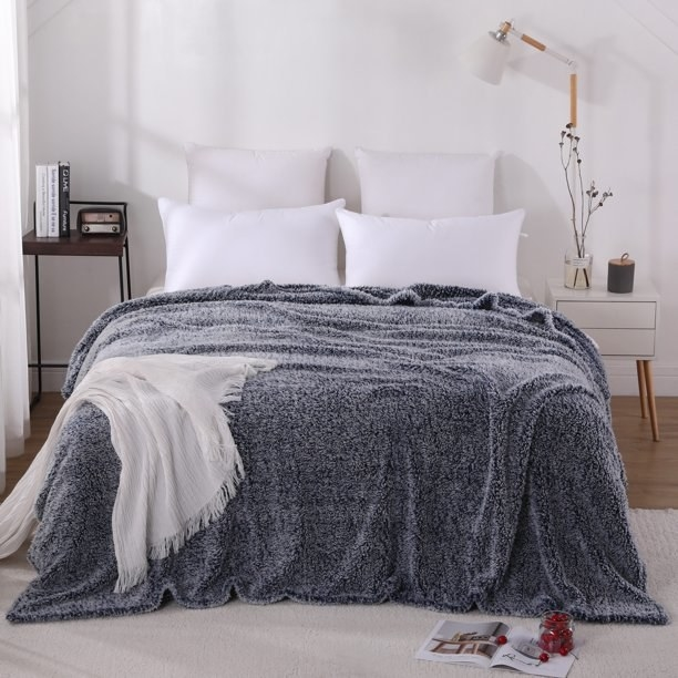 The blue blanket on top of a bed