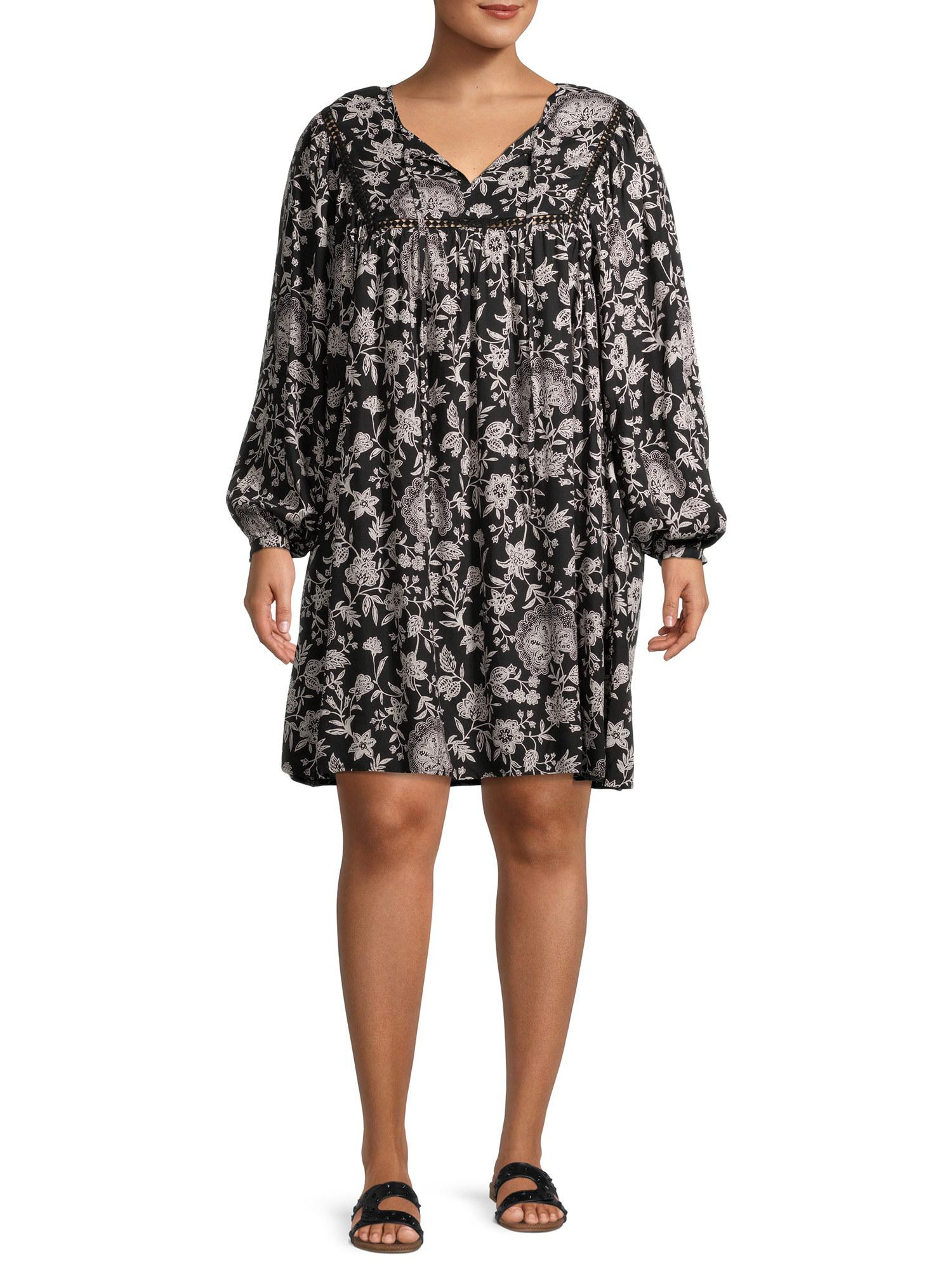 Model wears the paisley dress