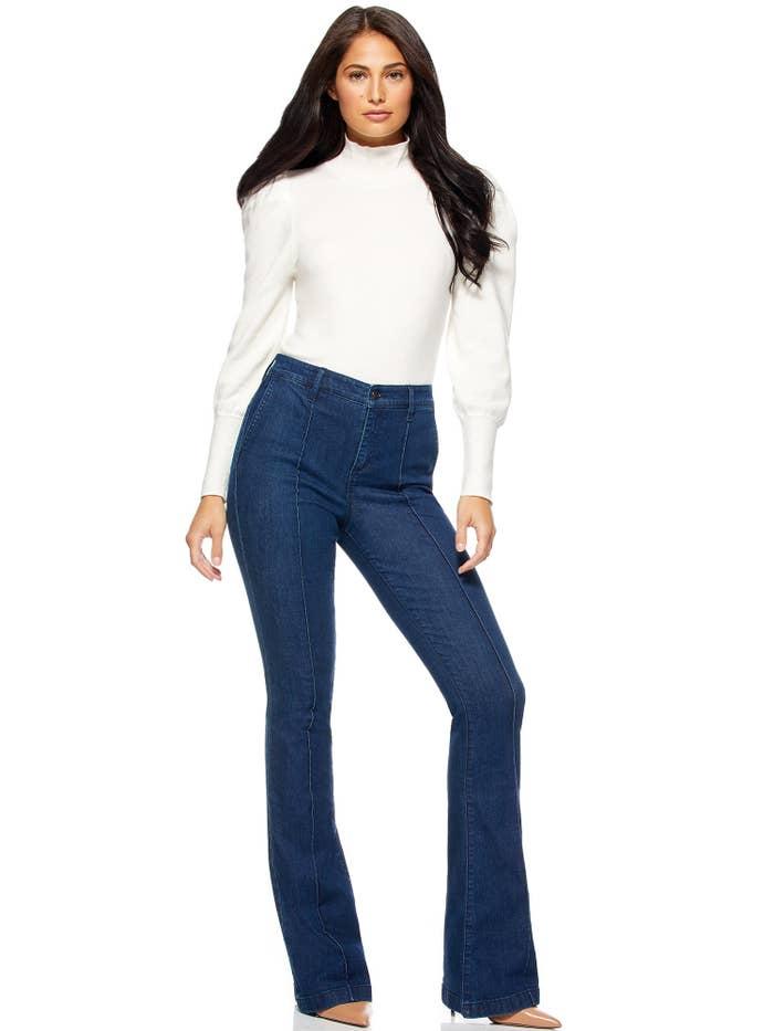 Model wears the ivory bodysuit
