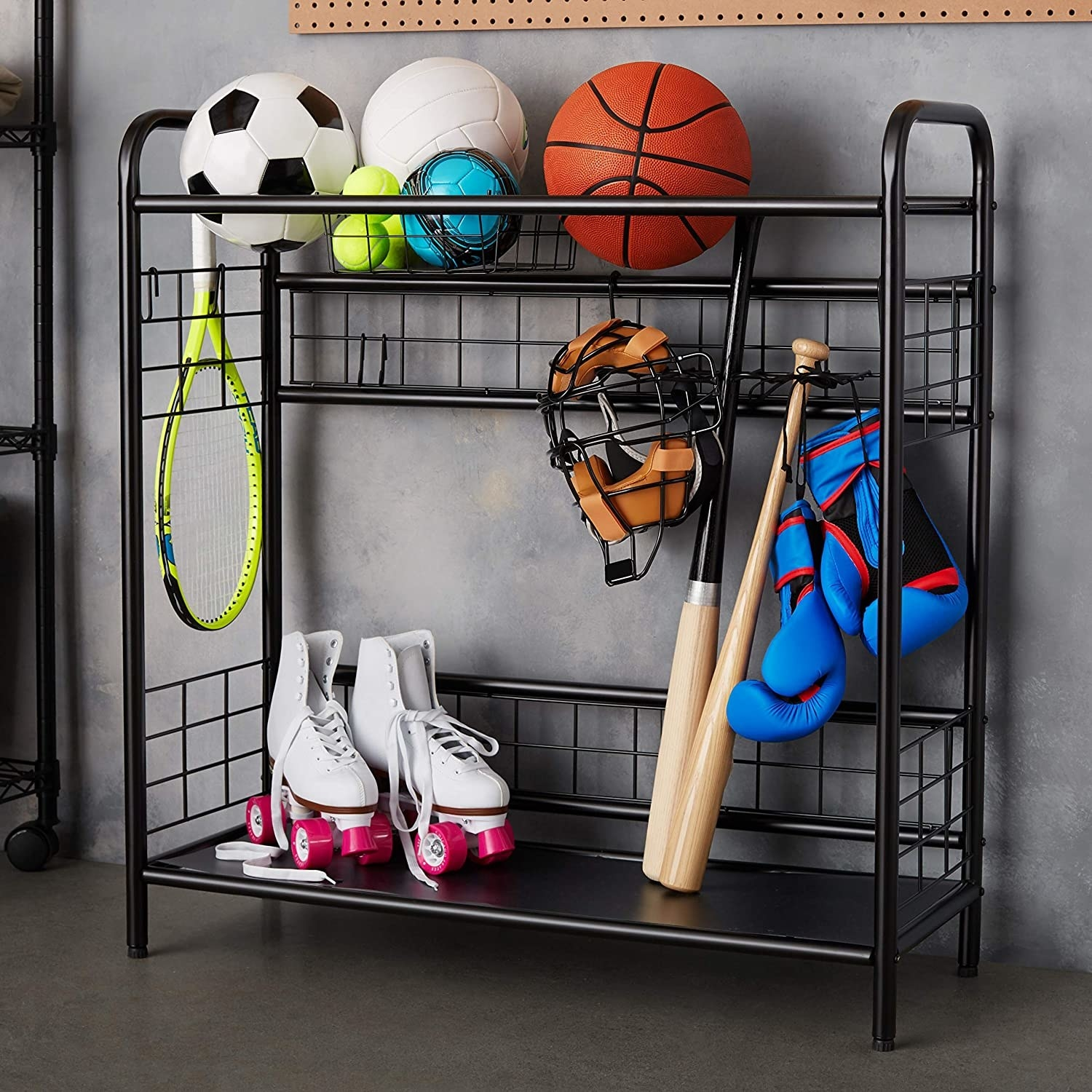 A metal rack with two shelves There are sports balls on the top rack and a pair of roller skates on the bottom