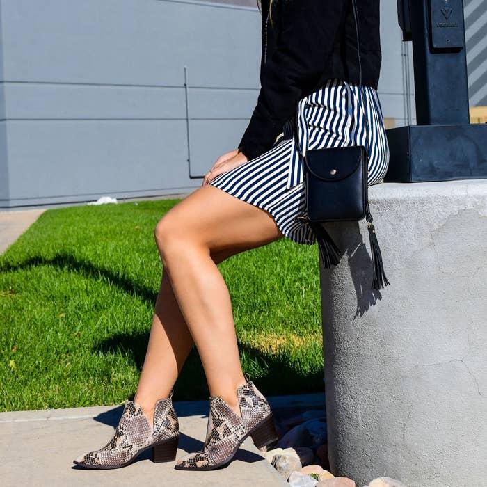 Model wears the snakeskin print booties