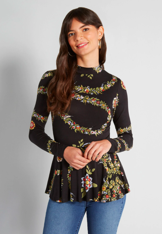 a black top with long sleeves and a floral print with a flair bottom