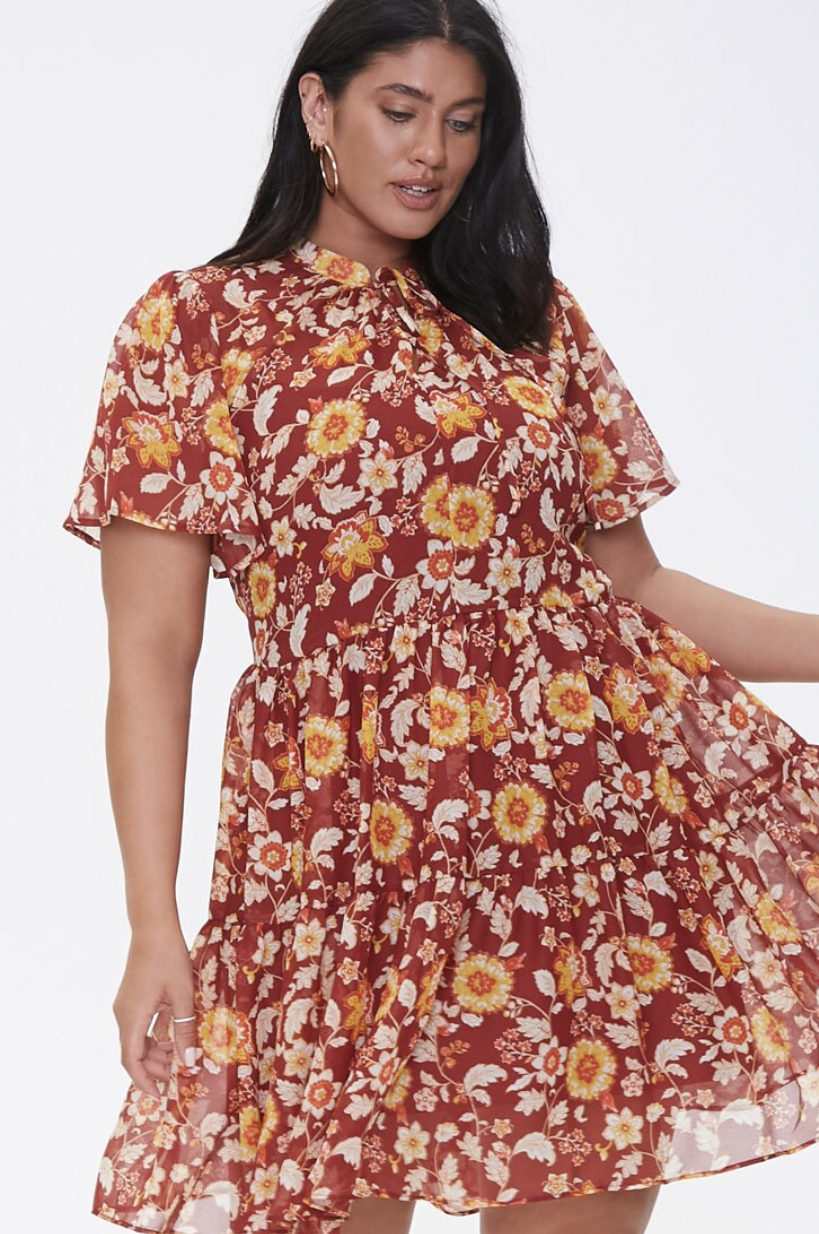 Model in a tiered knee-length chiffon dress in orange, yellow, and maroon