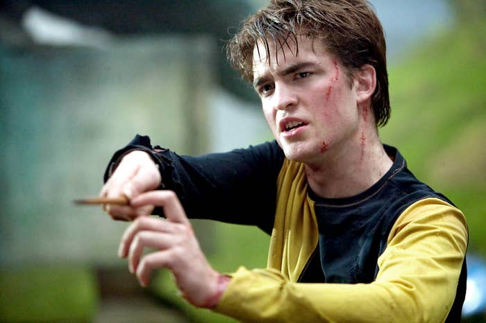 Cedric Diggory holding his wand
