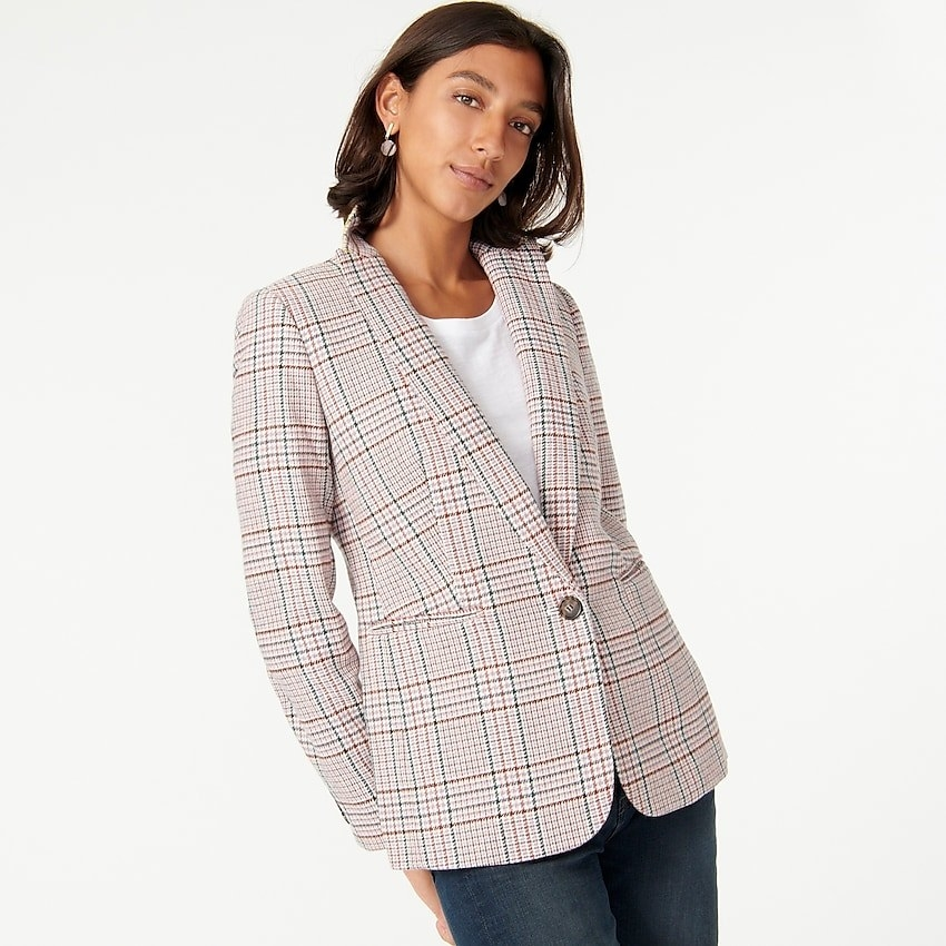 A model in the white, blue, lavender, and brown plaid blazer