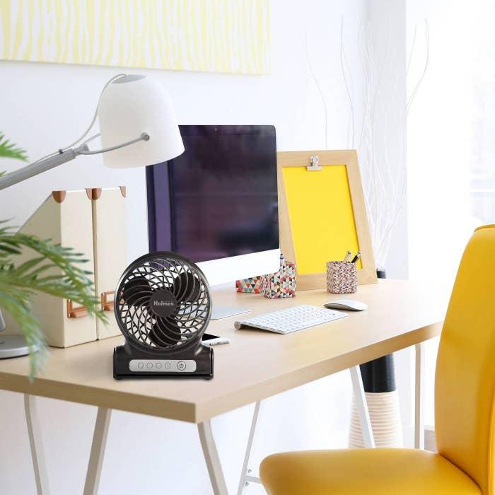 black rechargable fan on desk