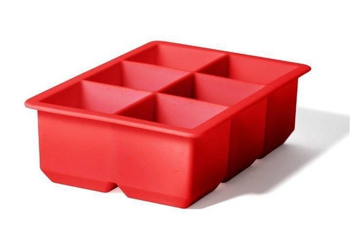 red silicone ice tray on a white background