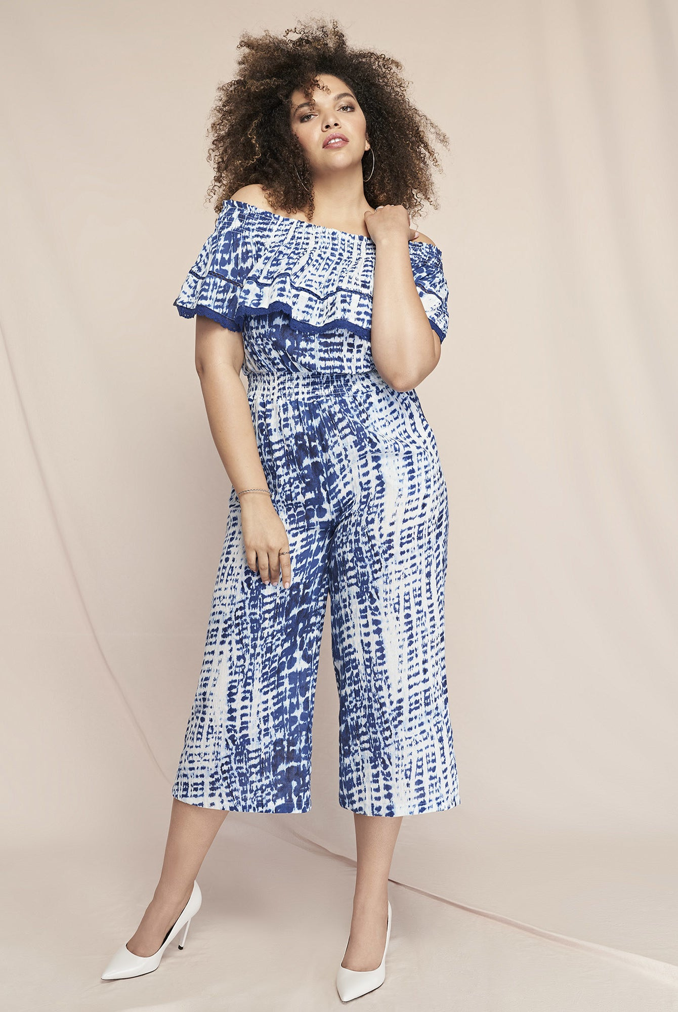 Model wearing the blue and white patterned jumpsuit