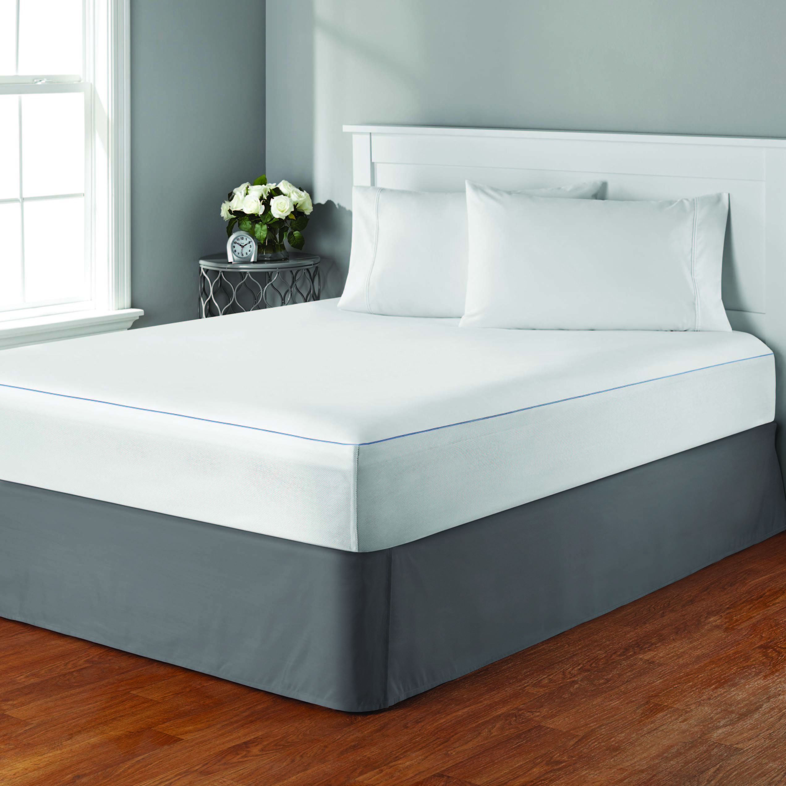 A mattress protector on top of a bed