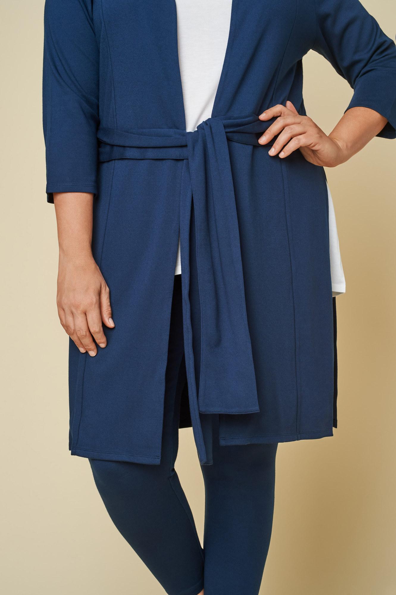 Model wears the long belted cardigan in navy