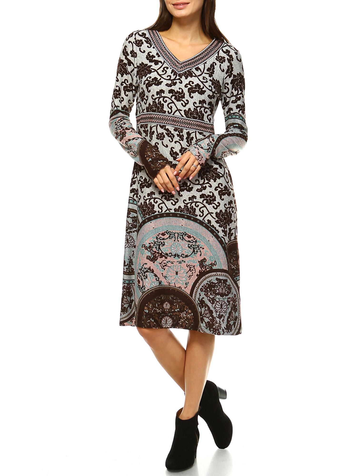 Model wears the floral patterned dress