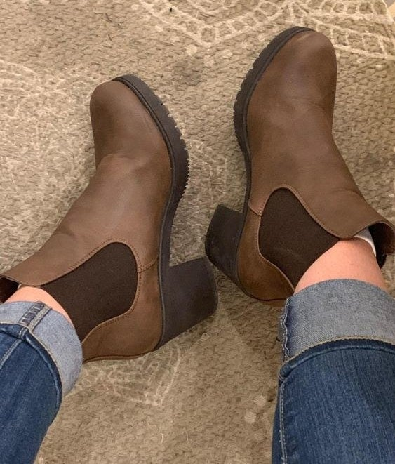Reviewer wearing the brown heeled Chelsea boots