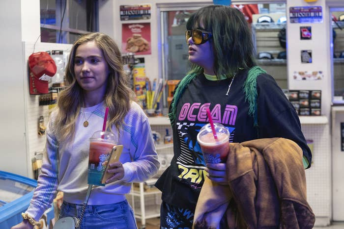 Veronica and Bailey hold slushies in a gas station store