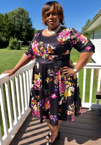 A different reviewer wearing the dress in navy blue.