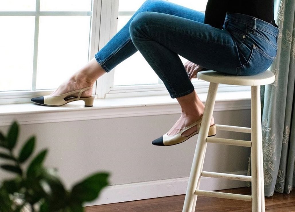 Model wearing the tan slingbacks with black toes