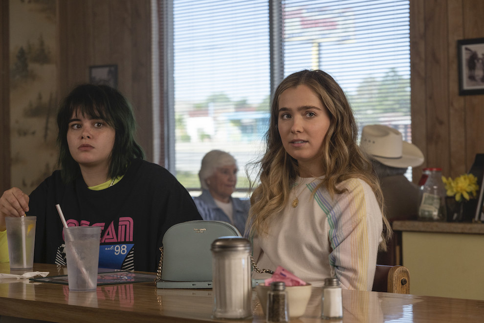 The teens sit in a diner