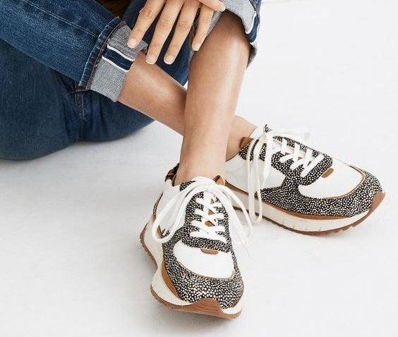 Model wearing the animal print training sneakers