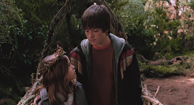 Jess looking at his sister May Belle while they're crossing the bridge to Terabithia