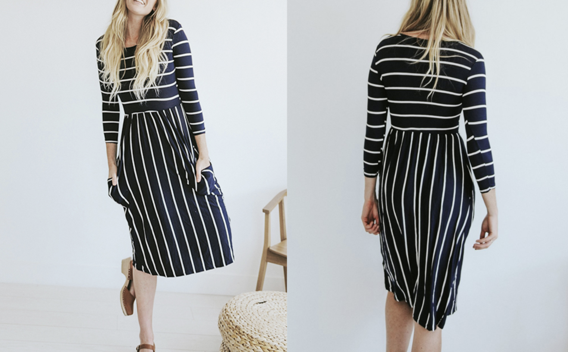 Model in a black dress with white stripes and 3/4 sleeves