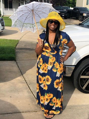 A different reviewer wearing the maxi in navy with yellow sunflowers all over it
