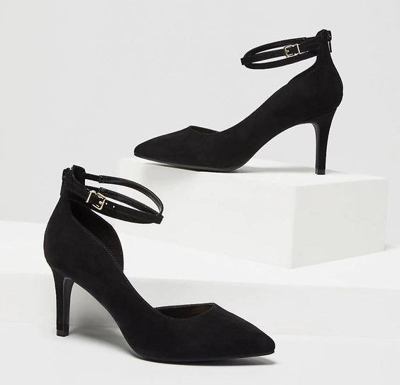 The black pointed toe high heels with ankle straps