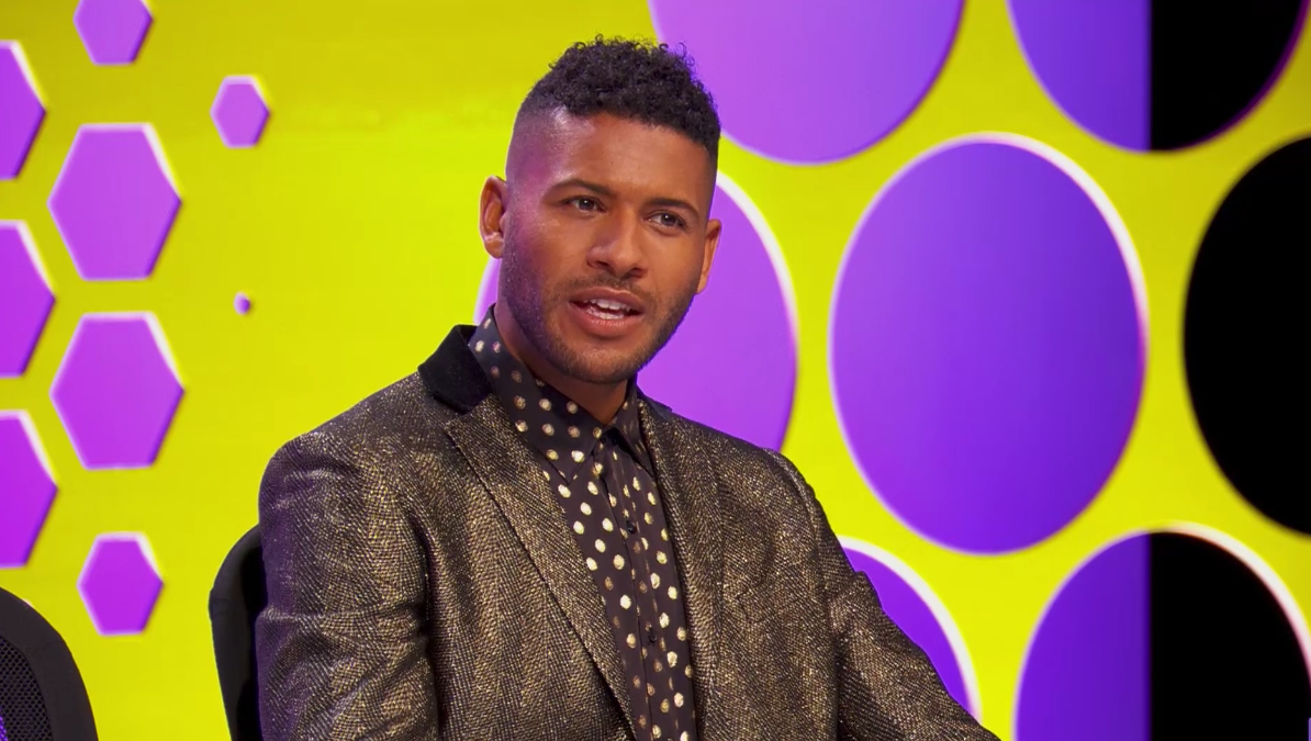 A screenshot of Jeffrey Bowyer-Chapman at the judges table during a runway