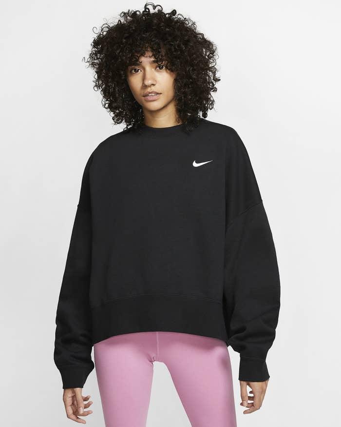 Model wearing the sweatshirt in black