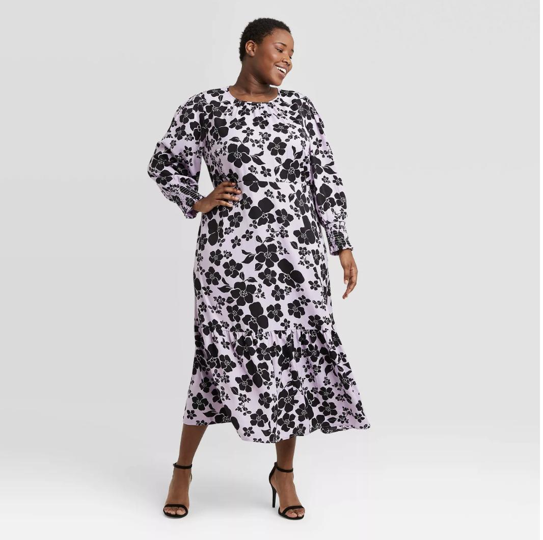 Model in light purple midi dress with black floral