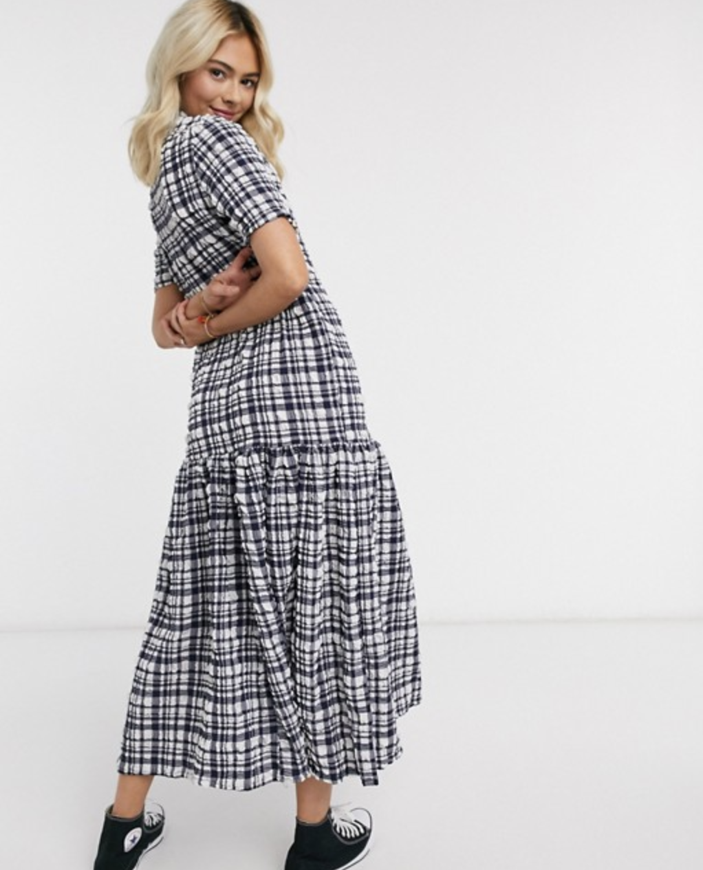 Model in a black and white checkered tiered maxi dress with short sleeves