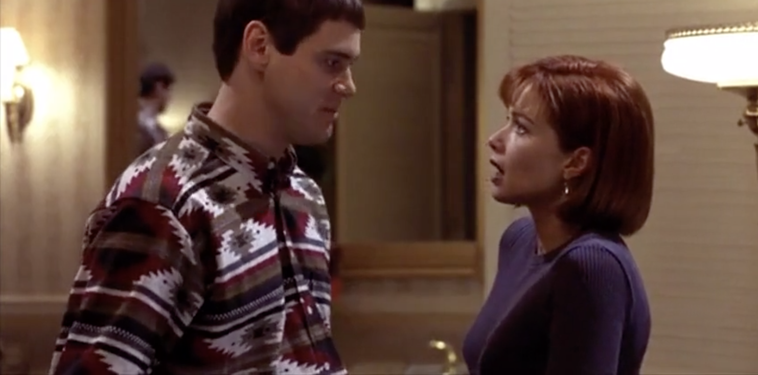 Jim Carrey as Lloyd Christmas looks longingly at Lauren Holly as Mary Swanson