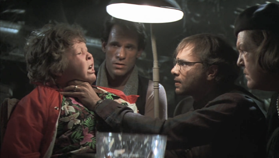 The Fratelli Brothers choke Chunk in the movie