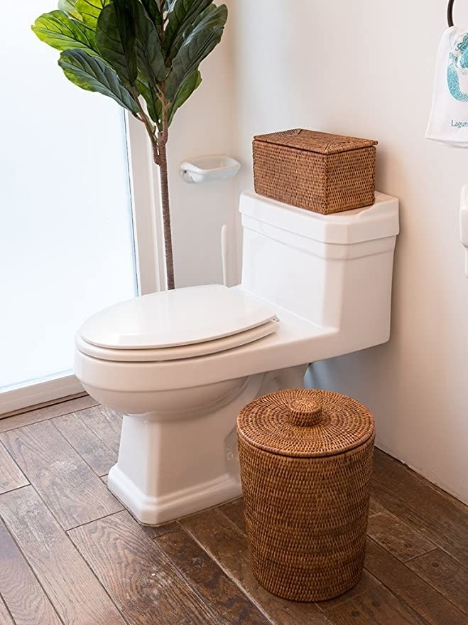 The Kouboo La Jolla Rattan Round waste basket with Plastic Insert & Lid in a bathroom