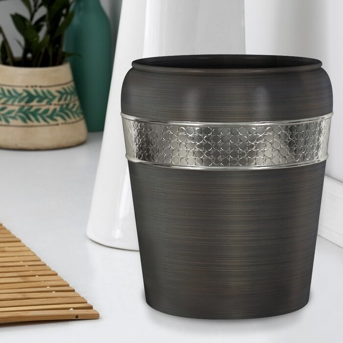 The Oil rubbed bronze Flannel Mod Stainless Steel Waste Basket in a bathroom