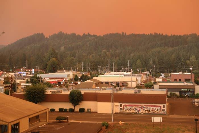 An orange smoke-filled sky is seen above Estacada, Oregon, on September 9, 2020, as fires burn nearby.