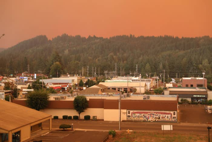 An orange smoke-filled sky is seen above Estacada, Oregon, on September 9, 2020, as fires burn nearby.