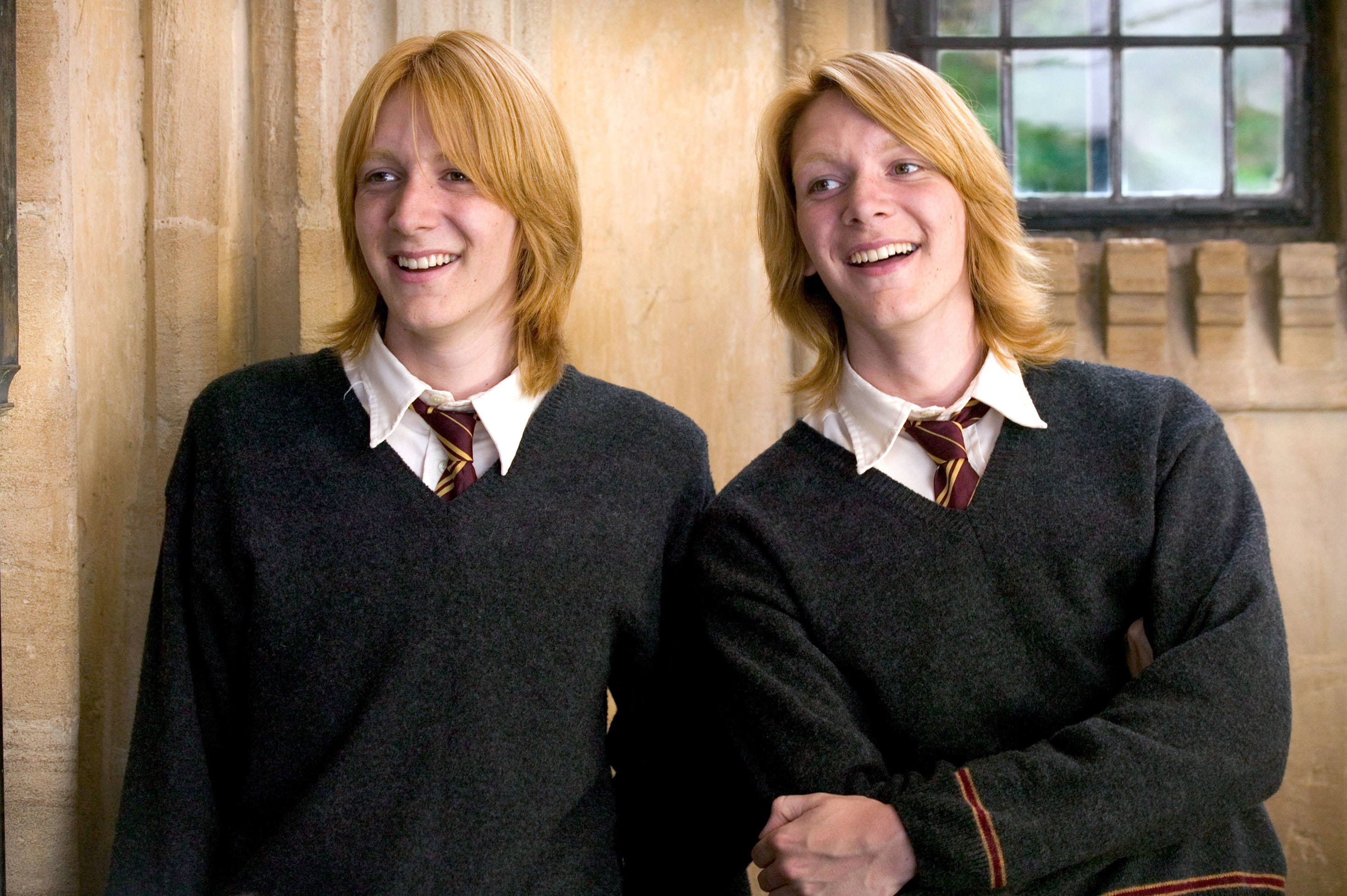 Fred and George laughing together