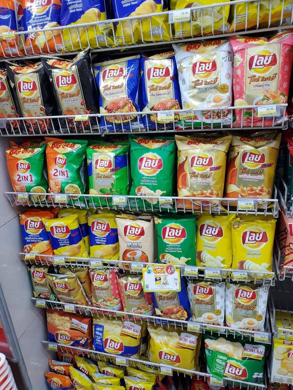 A whole wall of different flavored Lays chips