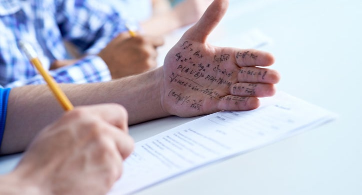 A student uses his palm as a cheat sheet for his test