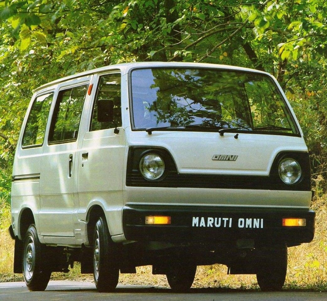 a maruti omni is parked on an empty street