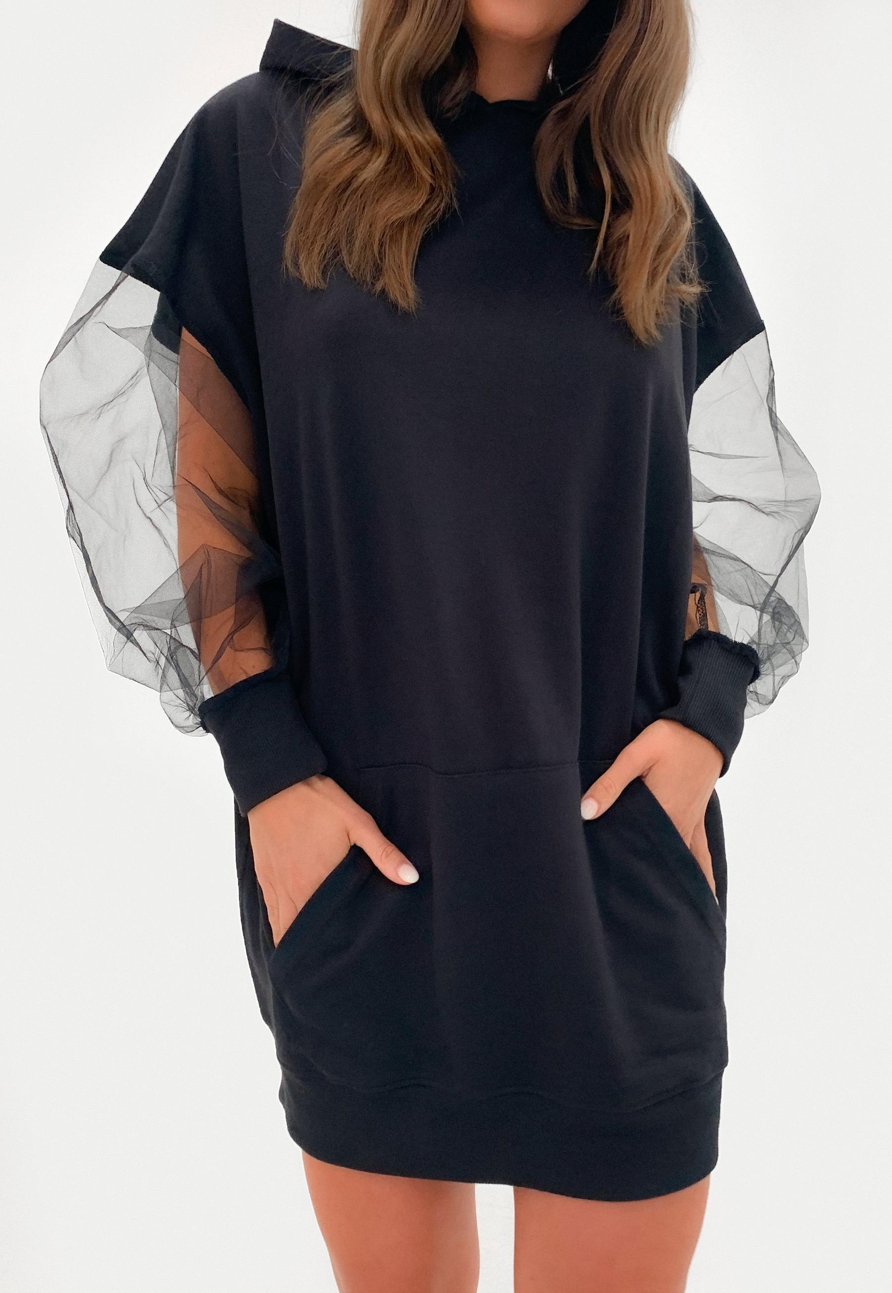 Model in the hoodie dress with sheer puffy sleeves