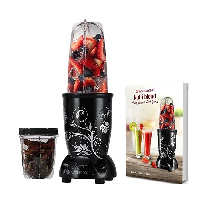 Picture of the blender with some strawberries in it.