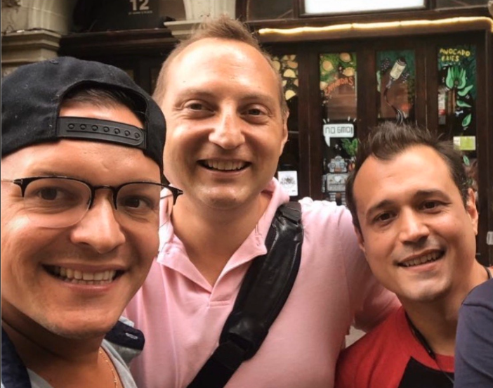 Alex, Steve & Danny, owners of Vspot smiling for the camera in front of their East Village location