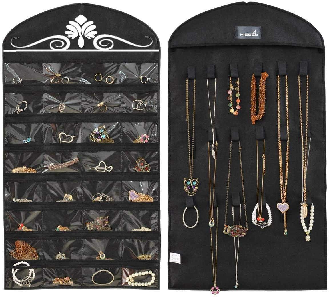 The two sided jewellery hanger which has pockets for earrings, bracelets and rings, and the other side has room to hang necklaces