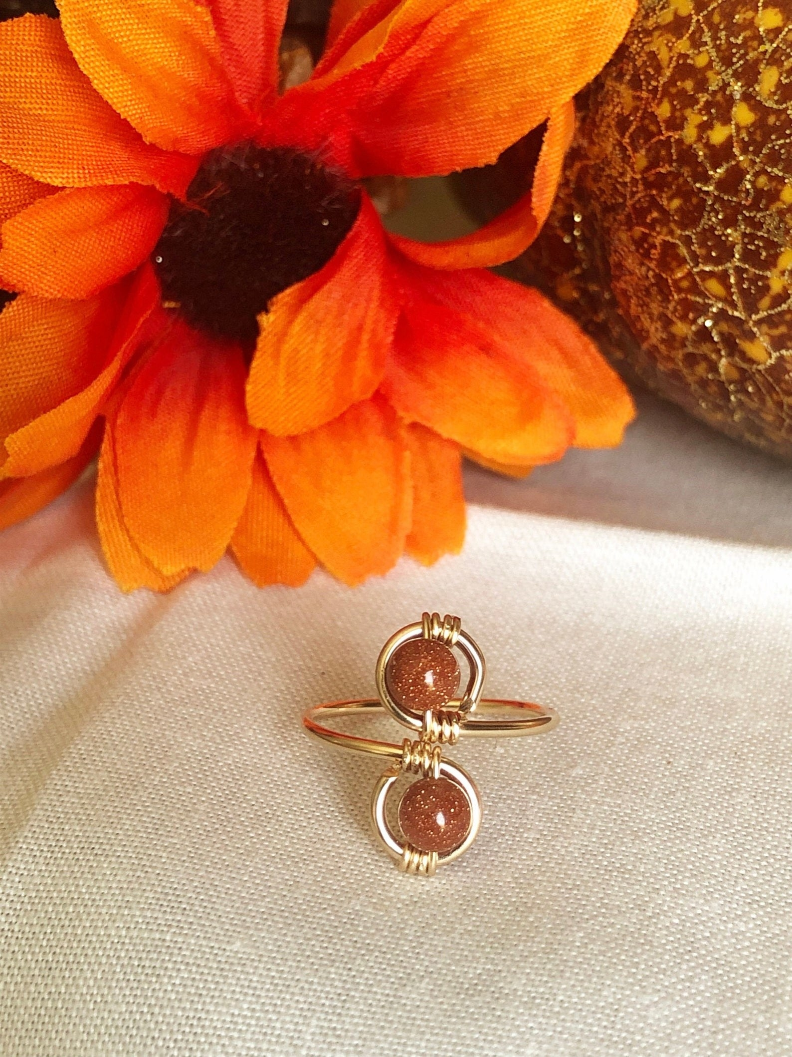 The ring with double hoops for double brown gemstones