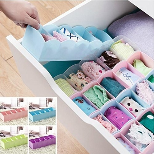 A drawer with neatly arranged undergarments placed in the organiser.
