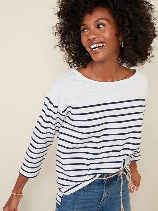 Model wearing the white top with navy blue thin horizontal stripes