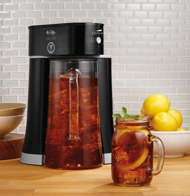 mr coffee iced tea maker with glass pitcher brewing a black iced tea