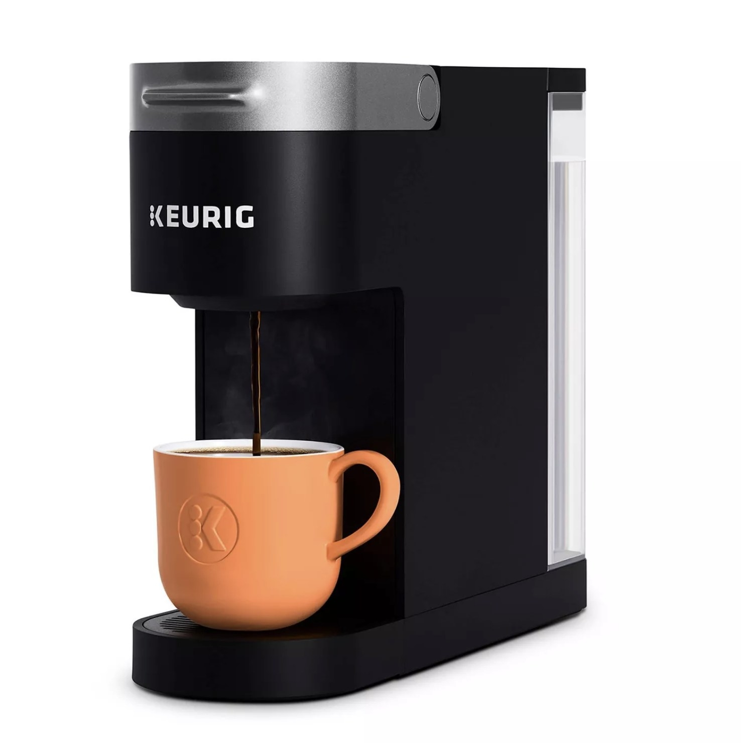 A black Keurig Slim k-cup coffee maker pouring coffee into an orange mug